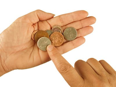 It is Possible to Make Money with Wealthy Affiliate - a few pennies in a hand
