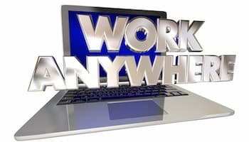 laptop with sign saying work anywhere
