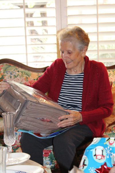 the author's elderly mother opening a Christmas present
