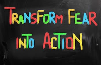 transform fear into action written on a blackboard