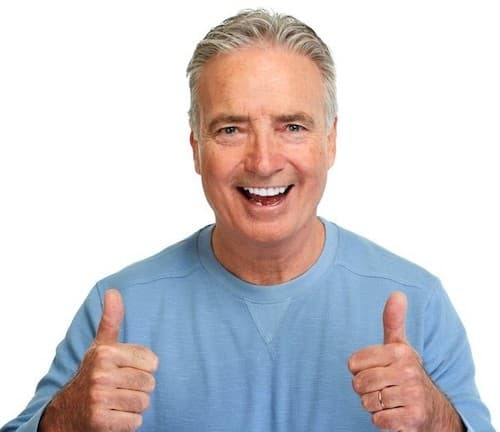 man laughing and giving two thumbs up