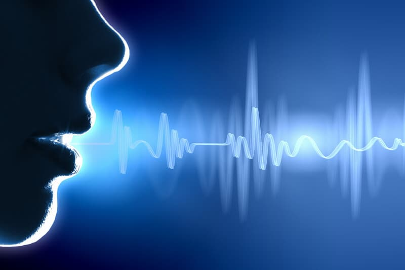 representation of sound waves coming from a female mouth