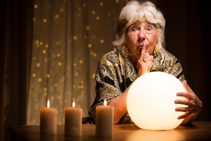 older lady fortune teller with crystal ball