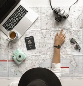 person planning a trip on a map